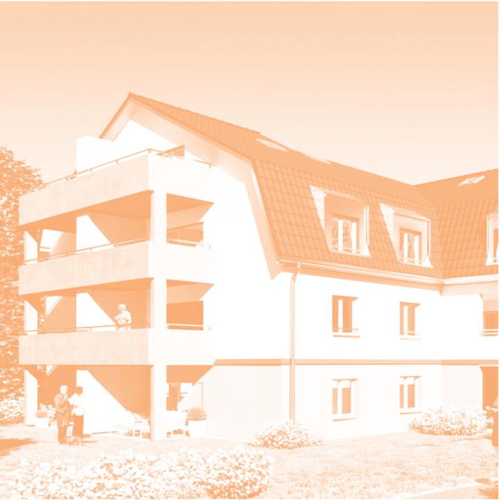 Ein oranges Foto von einem Haus mit 4 Stockwerken.